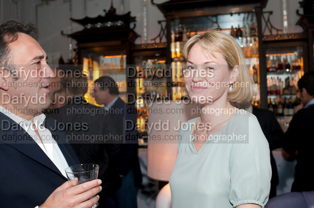 GEORGE KATZAROS; FRANCES KATZAROS, Henry Porter hosts a launch for Songs of Blood and Sword by Fatima Bhutto. The Artesian at the Langham London. Portland Place. 15 April 2010.  *** Local Caption *** -DO NOT ARCHIVE-© Copyright Photograph by Dafydd Jones. 248 Clapham Rd. London SW9 0PZ. Tel 0207 820 0771. www.dafjones.com.<br /> GEORGE KATZAROS; FRANCES KATZAROS, Henry Porter hosts a launch for Songs of Blood and Sword by Fatima Bhutto. The Artesian at the Langham London. Portland Place. 15 April 2010.