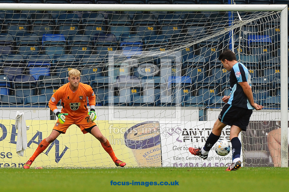 Peter Murphy of Wycombe Wanderers shoots at goal and Robert Lainton of Bury during the Sky Bet League 2 match at Adams Park, High Wycombe<br /> Picture by Seb Daly/Focus Images Ltd +447738 614630<br /> 06/09/2014