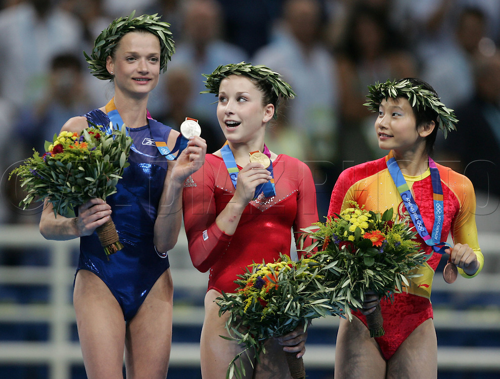 8/19/04 --Al Diaz/Miami Herald/KRT--Athens, Greece--Women's Individual All-Around Final Gymnastics Artistic at the Olympic Indoor Hall during the Athens 2004 Olympic Games. Left to right, Svetlana Khorkina of Russia wins the Silver, Carly Patterson wins the Gold and Nan Zhang wins the Bronze.