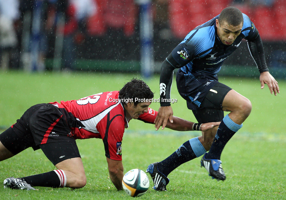 Jaques Fourie and Bryan Habana during the Super 14 match between the Lions and the Bulls held at Coca Cola Park in Johannesburg on the 28 Feb 2009..Photo by: Barry Aldworth/ SPORTZPICS