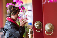 A woman prays at Hsi Lai Temple on February 8, 2013 in Los Angeles, California, ahead of the Lunar New Year. Preparations continue for the Lunar New Year which will celebrate the Year of the Snake on February 10.  (Photo by Ringo Chiu/PHOTOFORMULA.com).