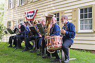 Old Bethpage, New York, USA. August 30, 2015. The Old Bethpage Village Brass Band performs a concert behind the Noon Inn during the Old Time Music Weekend at Old Westbury Village Restoration in Long Island. Popular music of the Civil War period was performed.