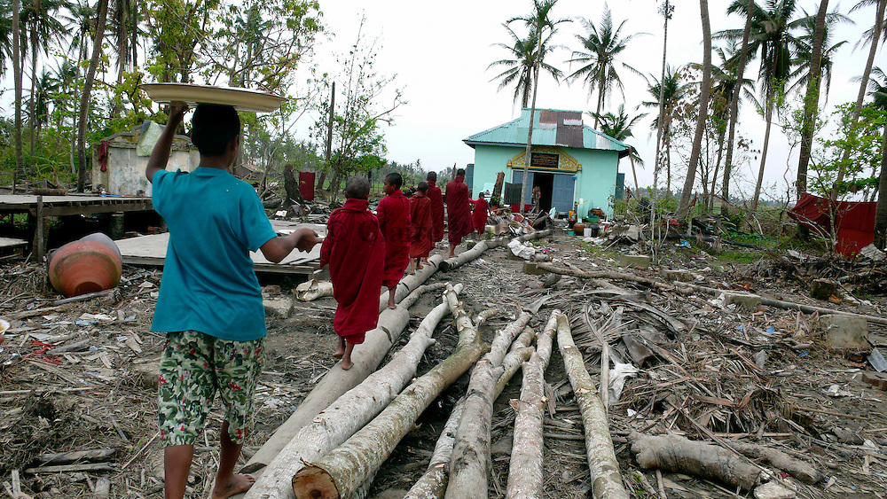 Buddhist monks at a destroyed monastery in Pyapon. All villages surrounding the temple have been destroyed.