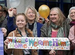 © Licensed to London News Pictures. 19/10/2016. Croydon, UK. People from a local church group show their support as a third group of migrants arrive from the Calais jungle camp at the Home Office immigration centre in Croydon. British authorities are bringing over about 100 children this week to be reunited with their relatives. French authorities are expected to start dismantling the camp this week. Photo credit: Peter Macdiarmid/LNP