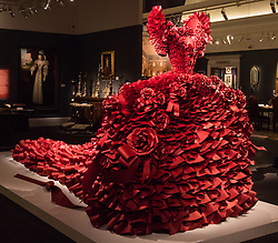 "Sotheby's, London, January 14th 2016. Paper artist ZOE BRADLEY exhibits spectacular paper sculptures inspired by the fashion in old master paintings. Her astonishing works are exhibited alongside 460 royal and aristocratic heirlooms  that will appear in Sotheby's ""Of Royal and Noble Descent"" auction to be held between 14th and 18th January. PICTURED: A monumental red ruffle gown  made up of 5,940 ruffles of paper. ///FOR LICENCING CONTACT: paul@pauldaveycreative.co.uk TEL:+44 (0) 7966 016 296 or +44 (0) 20 8969 6875. ©2015 Paul R Davey. All rights reserved."