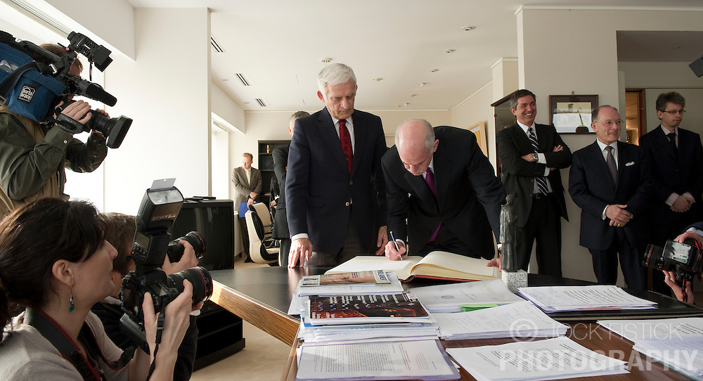 George Papandreou, Greece's prime minister, right, signs the guest book of Jerzy Buzek, president of the European Parliament, before their meeting at the the EU Parliament headquarters in Brussels, Belgium, on Thursday, March 18, 2010. (Photo © Jock Fistick)