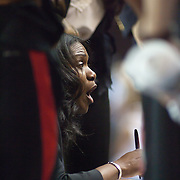 Northeastern Head Coach Daynia La-Force coaching her playing during a time out in the Northeastern huddle in first half of an NCAA college basketball game against Delaware Sunday, Feb. 26, 2012 at the Bob Carpenter Center in Newark, Del.