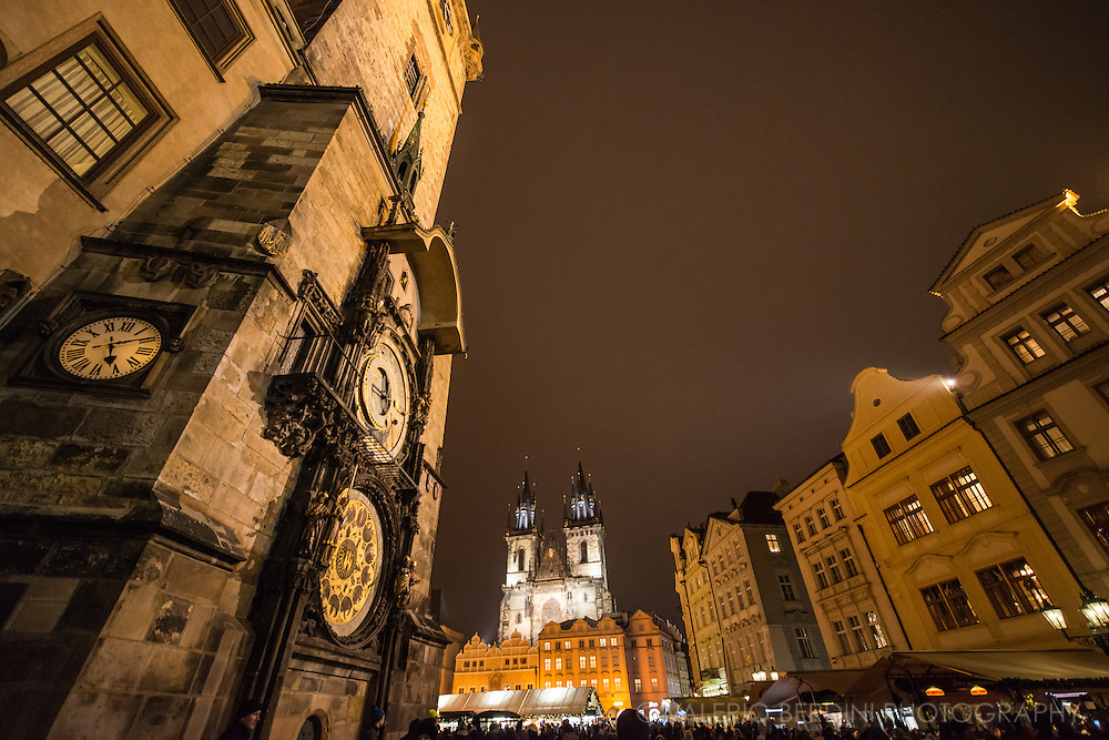 Prague astronomical clock on the city town hall and Church of Our Lady before Týn on the back of Old Town Square