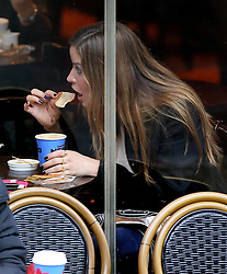 Former WAG Elen Rivas wearing a black jacket, peach blouse, skinny jeans and a pair of very pointed ankle boots out in north London. The Spanish model went to a Caffè Nero with a friend for a coffee and a biscuit which seem to enjoy, judging by the look on her face... 15/01/2014<br />BYLINE MUST READ : JAMESY/GOTCHA IMAGES<br /><br />Copyright by © Gotcha Images Ltd. All rights reserved.<br />Usage of this image is conditional upon the acceptance <br />of Gotcha Images Ltd, terms and conditions available at<br />www.gotchaimages.com