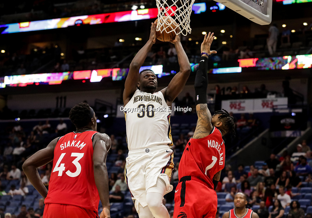 Oct 11, 2018; New Orleans, LA, USA; New Orleans Pelicans forward Julius Randle (30) shoots over Toronto Raptors forward Pascal Siakam (43) and center Eric Moreland (1) during the second half at the Smoothie King Center. Mandatory Credit: Derick E. Hingle-USA TODAY Sports