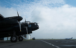 © Licensed to London News Pictures. <br /> 28/08/2014. <br /> <br /> Durham Tees Valley Airport, United Kingdom<br /> <br /> One of only two remaining flying Avro Lancaster bombers is brought out of the hangar as it visits Durham Tees Valley airport today. <br /> <br /> The aircraft, 'Mynarski' is named after Pilot Officer Andrew Mynarski who flew with the Canadian Royal Air Force from the airport which was then called RAF Middleton St George.<br /> <br /> Pilot Officer Mynarski was posthumously awarded a VC after giving his life while trying to save a colleague when their Lancaster was shot down in June 1944.<br /> <br /> The famous World War Two aircraft is owned by the Canadian Warplane Heritage Museum and is beginning a 2-week tour of the UK.<br /> <br /> Photo credit : Ian Forsyth/LNP