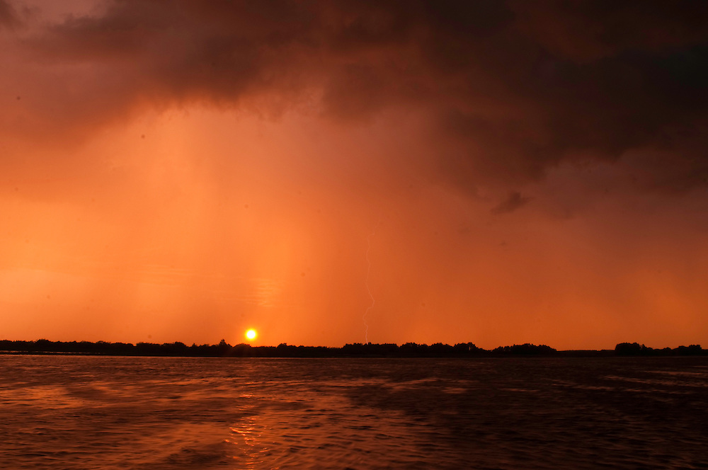 Sunset with lightning on Prypiat river, Belarus