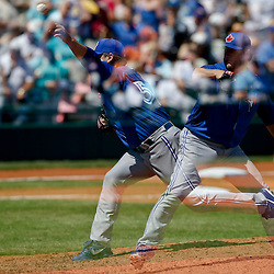 Mar 13, 2013; Bradenton, FL, USA; (editors note: multiple exposure image) Toronto Blue Jays starting pitcher Mark Buehrle (56) throws against the Pittsburgh Pirates during the bottom of the fourth inning of a spring training game at McKechnie Field. Mandatory Credit: Derick E. Hingle-USA TODAY Sports