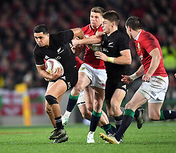 Anton Lienert-Brown of New Zealand slips the tackle of Owen Farrell of the Lions in the third International rugby test match between the the New Zealand All Blacks and British and Irish Lions at Eden Park, Auckland, New Zealand, Saturday, July 08, 2017. Credit:SNPA / Ross Setford  **NO ARCHIVING""