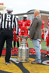 03 October 2015:  Jay Blunk, a member of the Chicago Blackhawks organization stands at mid field with the Stanley Cup for the coin toss.  Tre Roberson(5) is in the background. NCAA FCS Football between Northern Iowa Panthers and Illinois State Redbirds at Hancock Stadium in Normal IL (Photo by Alan Look)