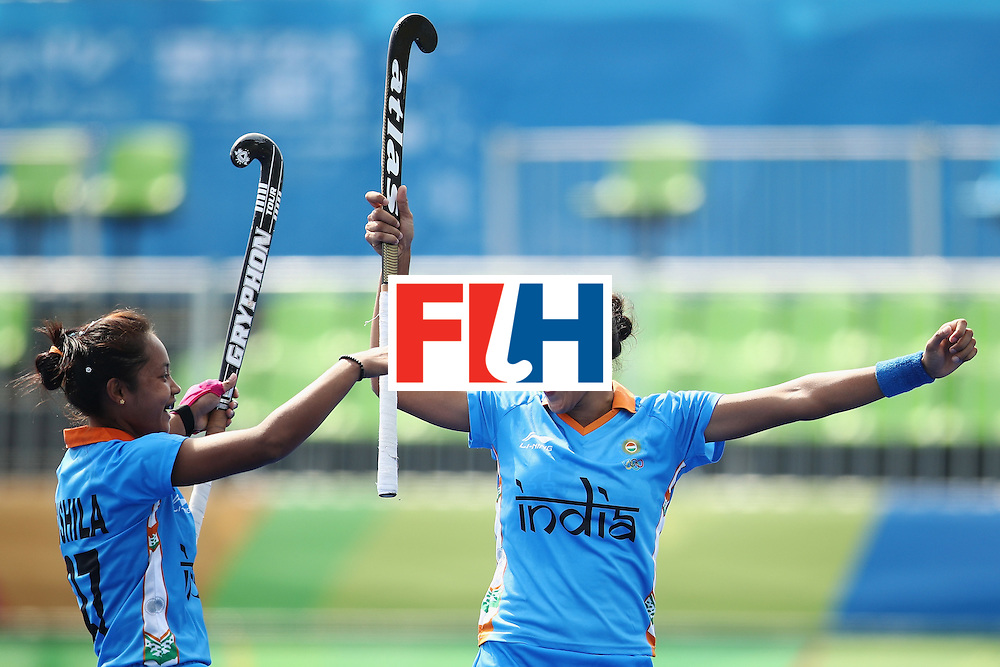 RIO DE JANEIRO, BRAZIL - AUGUST 07:  Sushila Pukhrambam and Rani of India celebrate Rani scoring a goal during the women's pool B match between Japan and India on Day 2 of the Rio 2016 Olympic Games at the Olympic Hockey Centre on August 7, 2016 in Rio de Janeiro, Brazil.  (Photo by Mark Kolbe/Getty Images)