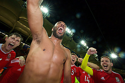 TOULOUSE, FRANCE - Monday, June 20, 2016: Wales players celebrate in a team-huddle after the 3-0 victory over Russia and reaching the knock-out stage during the final Group B UEFA Euro 2016 Championship match at Stadium de Toulouse. Ben Davies, captain Ashley Williams, Simon Church, goalkeeper Daniel Ward. (Pic by David Rawcliffe/Propaganda)