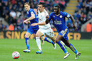 Leicester City forward Jeff Schlupp attacks watched by Swansea City midfielder Jack Cork during the Barclays Premier League match between Leicester City and Swansea City at the King Power Stadium, Leicester, England on 24 April 2016. Photo by Alan Franklin.