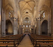 Nave with cross vaulted ceiling, looking towards the altar, in the Cathedral of St Mary, designed by Benito Dalguayre in Catalan Gothic style and begun 1347 on the site of a Romanesque cathedral, consecrated 1447 and completed in 1757, Tortosa, Catalonia, Spain. The cathedral has 3 naves with chapels between the buttresses and an ambulatory with radial chapels. Picture by Manuel Cohen