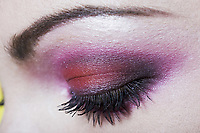 caucasian woman eye  makeup with pink eyeshadow