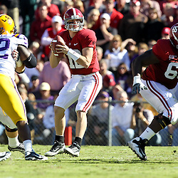 November 6, 2010; Baton Rouge, LA, USA;  Alabama Crimson Tide quarterback Greg McElroy (12) looks to pass during the first half against the LSU Tigers at Tiger Stadium.  Mandatory Credit: Derick E. Hingle