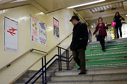 © Licensed to London News Pictures. 03/12/2011, London, UK. A man looks at posters leading to the station's platforms. Staff working at Richmond Station in London have uncovered railway posters from the late 1980's whilst upgrading poster holders. Photo credit : Stephen Simpson/LNP