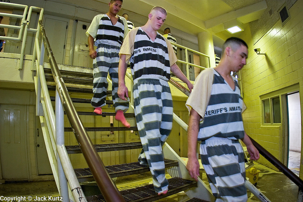 "24 MARCH 2004 - PHOENIX, AZ, USA: Juveniles sentenced as adults line up outside their cells during morning cell count in the Maricopa County Jail in Phoenix, AZ, March 24, 2004. The juveniles volunteer to serve Maricpoa County Sheriff Joe Arpaio's chain gang. The sheriff, who claims to be ""the toughest sheriff in America,"" has chain gangs in both the men's and women's jails and now has a chain gang for juveniles sentenced and serving time as adults in the county jail system. The sheriff claims it is the only juvenile chain gang in the country.   PHOTO BY JACK KURTZ"