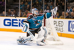 January 6, 2010; San Jose, CA, USA; San Jose Sharks goalie Evgeni Nabokov (20) makes a glove save during the third period against the St. Louis Blues at HP Pavilion.  San Jose defeated St. Louis 2-1 in overtime. Mandatory Credit: Jason O. Watson / US PRESSWIRE
