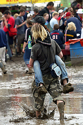 © Licensed to London News Pictures. 23/06/2014. Somersert, UK ***FILE PICTURE***. A wet Glastonbury 2007. The weather forecast for this year's festival is for heavy rain. The festival starts on June 25th 2014. Photo credit : Jason Bryant/LNP