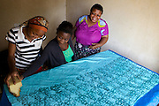 Asia Diwala sharing her Batik skills with her employees.<br /> <br /> Asia owns and runs a Batik business in KwaMatias, Tanzania.<br /> <br /> She attended MKUBWA enterprise training run by the Tanzania Gatsby Trust in partnership with The Cherie Blair Foundation for Women.