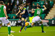 Adam Jackson (#18) of Hibernian FC attempts to block the shot from Blair Alston (#10) of Hamilton Academical FC during the Ladbrokes Scottish Premiership match between Hibernian FC and Hamilton Academical FC at Easter Road Stadium, Edinburgh, Scotland on 22 January 2020.