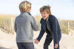two boys playing on the beach in The Fall