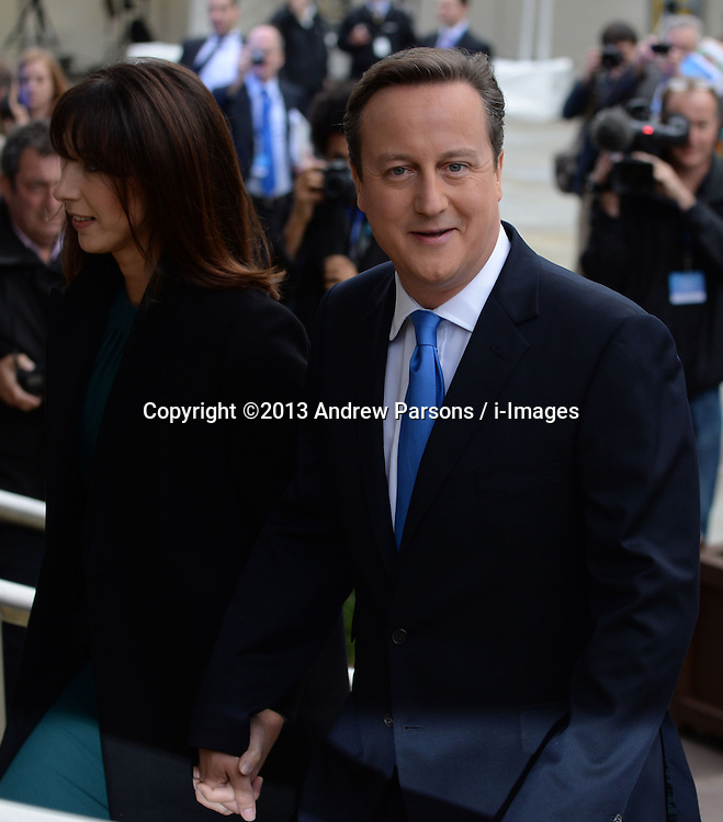 David Cameron Arrives for Keynote Speech.<br /> David Cameron with wife Samantha Cameron walking into the Conference Centre before his speech to the Conservative Party Conference, Manchester, United Kingdom. Wednesday, 2nd October 2013. Picture by Andrew Parsons / i-Images