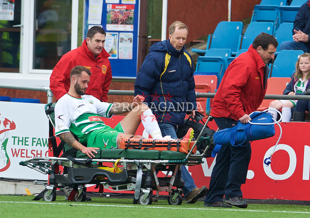 NEWTOWN, WALES - Saturday, May 2, 2015: The New Saints' xxxx is carried off injured during the FAW Welsh Cup final match against Newtown at Latham Park. (Pic by Ian Cook/Propaganda)