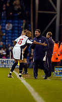 Photo: Leigh Quinnell.<br /> West Bromwich Albion v Manchester City. The Barclays Premiership. 10/12/2005. West Broms Diomansy Kamara celebrates his goal with manager Bryan Robson.