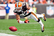 Nov. 14, 2010; Cleveland, OH, USA; Cleveland Browns cornerback Joe Haden (23) try to keep an onside kick in bounds during the first quarter against New York Jets at Cleveland Browns Stadium. Mandatory Credit: Jason Miller-US PRESSWIRE