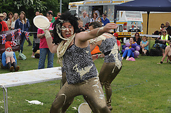 © Licensed to London News Pictures. 01/06/2013<br /> World Custard Pie Championships at Coxheath Village Hall Playing Fields in Kent (today 01.06.2013)<br /> The annual event of Custard Pie throwing is done in fancy dress with 4 people in each team. Judges award 6 points for face strikes,3 points for near miss from shoulder height and 1 point for hitting any other part of the body.<br /> Photo credit :Grant Falvey/LNP