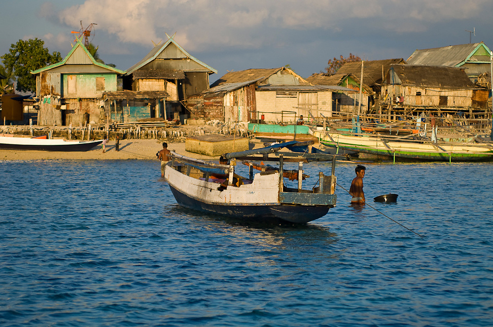 Fishing village inside Komodo National Park, Indonesia. The influx of people into the park threaten the region's fisheries.