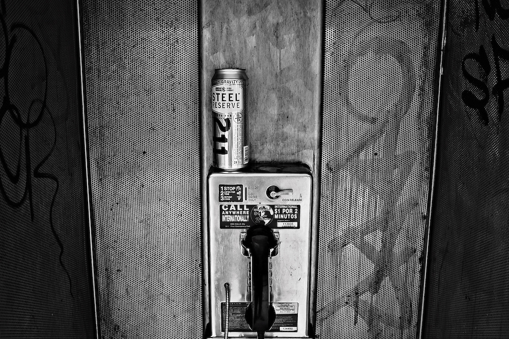 Malt liquor can atop pay phone, New York, NY, US