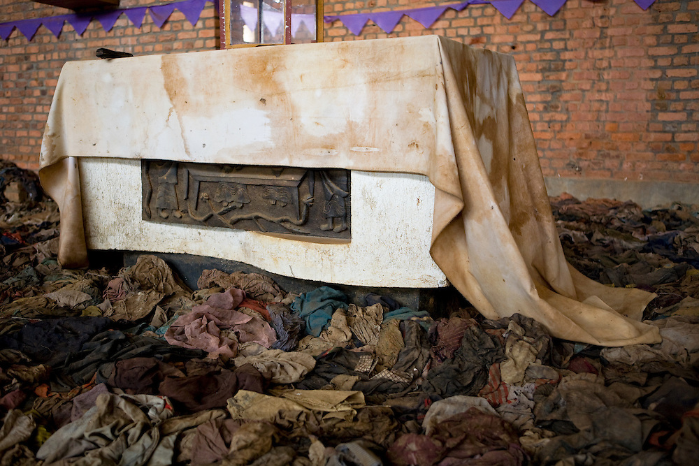 Bloodstained altar and victims' clothing in Nyamata Church memorial