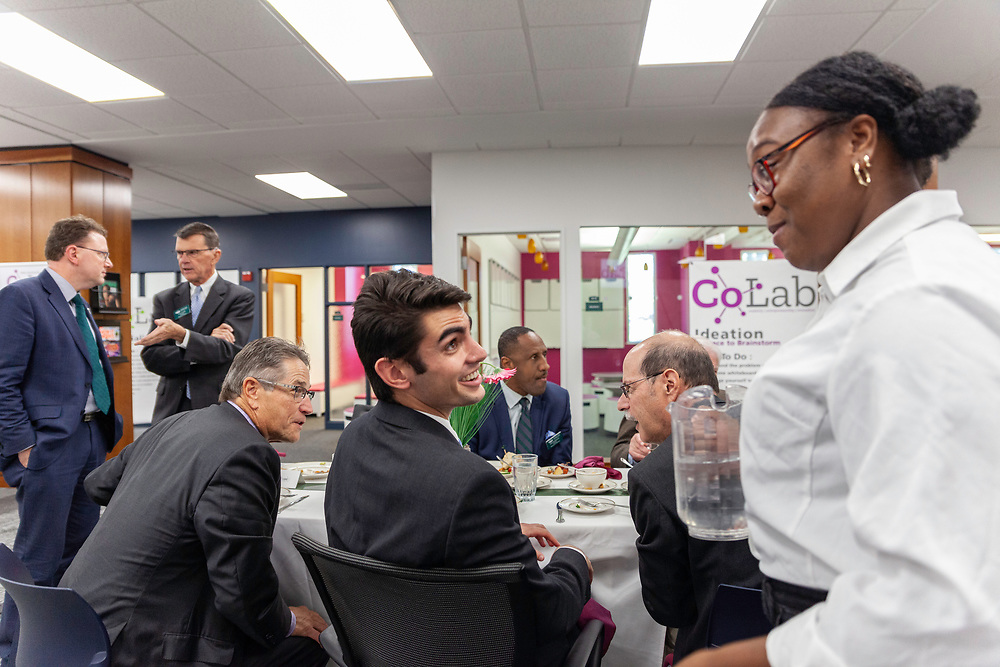 (Left to right) Dave Scholl, Board of Trustees chair; Austin McClain, a student trustee on the Board of Trustees and a junior in business economics; and Rosheedah Beatty, a senior in journalism, enjoy lunch and conversation at the grand opening and ribbon cutting for the new CoLab, October 18, 2018. (Photo by Stephen Zenner/Ohio University Libraries)