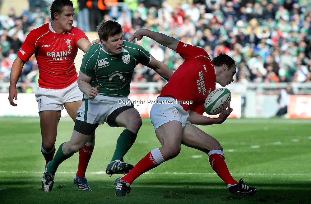 RBS Six Nations, Croke Park, 8/3/2008<br /> Ireland vs Wales<br /> Ireland's Brian O'Driscoll with Mark Jones and Lee Byrne of Wales<br /> Mandatory Credit &copy;INPHO/Morgan Treacy *** Local Caption ***