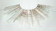 An Inca record keeping textile tool called a Quipu or Khipu.