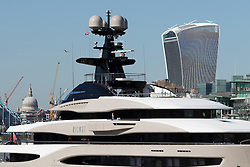 October 3, 2016 - London, London, UK - LONDON, UK.  Superyacht, Kismet leaves London on the River Thames passing in front of St Paul's Cathedral and the Walkie Talkie skyscraper during blue skies and sunny autumn weather this lunchtime, after mooring at Butlers Wharf last week. Kismet is 308 feet long and is reportedly owned by Pakistani-American billionaire Shahid Khan, who owns the National Football League (NFL) team, the Jacksonville Jaguars, who played the Colts in an International Series game at Wembley yesterday. Kismet has 6 staterooms, with the master bedroom having its own private deck with jacuzzi and helipad and can be chartered for an estimated £1m per week. (Credit Image: © Vickie Flores/London News Pictures via ZUMA Wire)