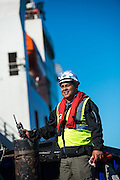 GAC Employee on the tugboat next to the Boa Sub C Multi purpose Offshore Vessel
