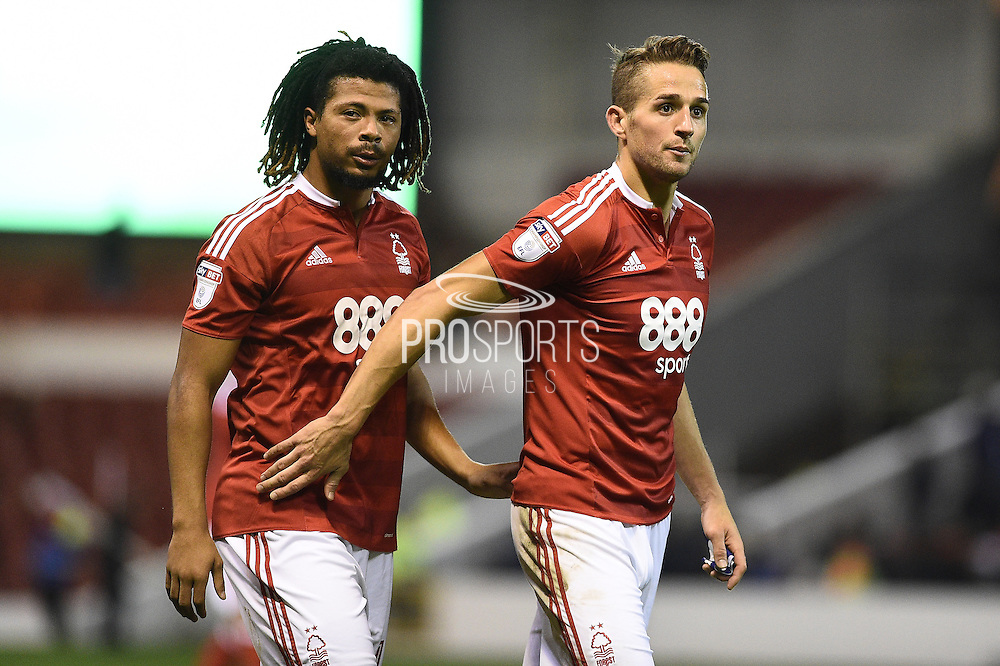 Nottingham Forest midfielder Hildeberto Pereira (17)  and Nottingham Forest midfielder Chris Cohen (8) during the EFL Sky Bet Championship match between Nottingham Forest and Birmingham City at the City Ground, Nottingham, England on 14 October 2016. Photo by Jon Hobley.