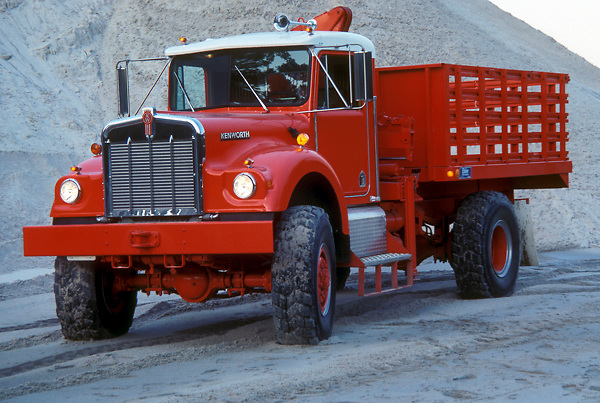 Red transport truck parked and ready to be loaded