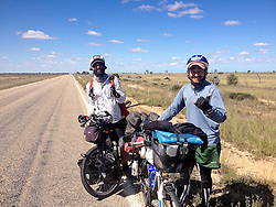 © Licensed to London News Pictures. 13/09/2013. Eyre Highway,<br /> Caiguna,Western Australia, Australia .James Ketchell meets some fellow cyclists in the remote part of Western Australia. They are taking a somewaht different and heavier laden approach.  The previous parts of James Ketchell's global triathlon were an Atlantic solo row in 2010 and summiting Everest in 2011.Photo credit : James Ketchell/LN