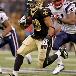 2009 November 30:  New Orleans Saints running back Pierre Thomas (23) runs away from New England Patriots linebacker Jerod Mayo (51) during a 38-17 win by the New Orleans Saints over the New England Patriots at the Louisiana Superdome in New Orleans, Louisiana.