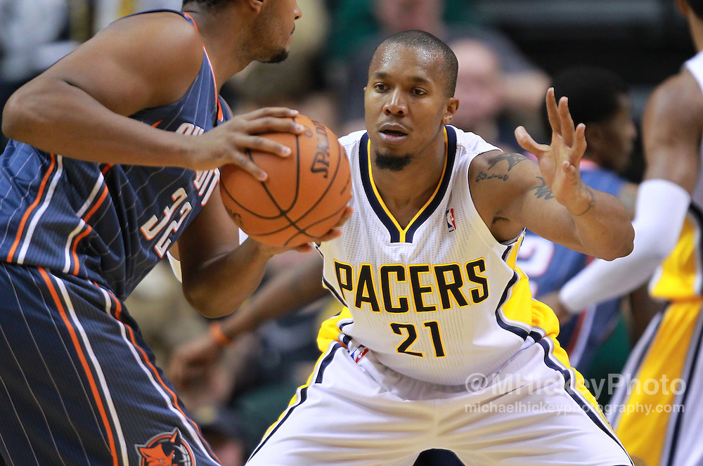 Jan. 07, 2012; Indianapolis, IN, USA; Indiana Pacers power forward David West (21) guards Charlotte Bobcats power forward Boris Diaw (32) at Bankers Life Fieldshouse. Mandatory credit: Michael Hickey-US PRESSWIRE